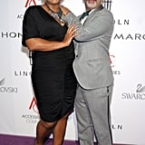 Queen Latifah and Christian Louboutin were affectionate on the red carpet.