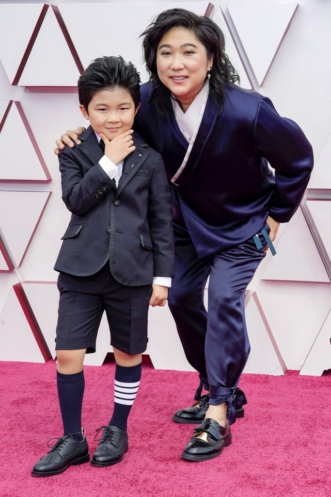 """Alan Kim had the cutest night at the Oscars, hands down. On Sunday, the 9-year-old Minari star showed up to the ceremony looking dapper in tuxedo shorts and knee-high socks. Alan, who was accompanied by producer Christina Oh, appeared to be having the most fun on the red carpet as he did a little dance and struck his best poses for the cameras.  Alan rang in his ninth birthday on Friday, and in an interview with E! News, he revealed some of his favorite gifts that he received. """"I got a FitBit for kids, a new bike obviously, a new iPad mini 5, and that was really cool,"""" he said. Alan also took home the Critics' Choice Award for best young performer last month, so clearly he has plenty of reasons to celebrate. On top of that, Minari was nominated in major categories like best picture and best original screenplay. See more of Alan's adorable night ahead.      Related:                                                                                                           Presenting the Wins and Misses of the 2021 Oscars"""