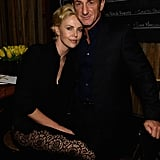 Charlize Theron cuddled up to Sean Penn at Pharrell Williams' pre-Oscars bash.