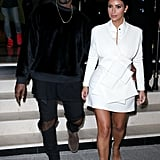 When Kim wore this white mini to a Paris fashion party, and Kanye kept it casual.