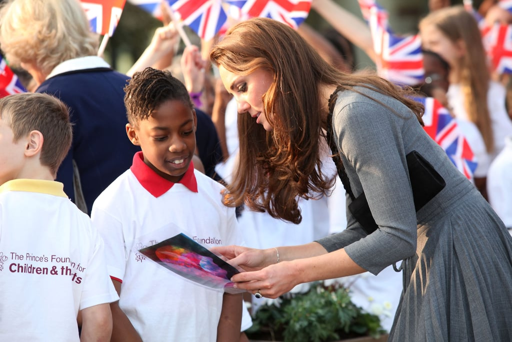 Kate Middleton talked with a little boy before leaving London's Dulwich Picture Gallery in March 2012.