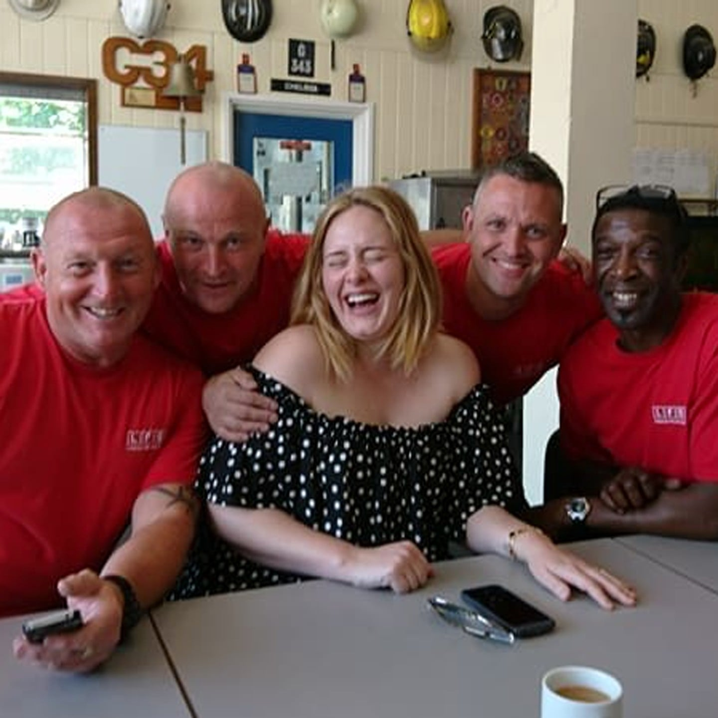 Adele visits Grenfell Tower firefighters for a cup of tea and a cuddle