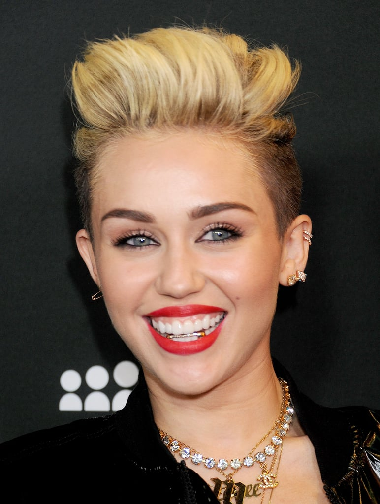 Miley Cyrus put her understated grill on display at a Myspace event in LA earlier this year.