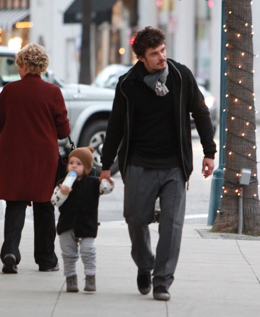 Orlando Bloom took his son Flynn out shopping in Beverly Hills on Friday. After spending much of November and December in NYC with mom Miranda Kerr, Flynn is now reunited with dad Orlando for the holidays. Orlando has been in South Africa filming Zulu, but he was able to take a break to watch Miranda walk in the annual Victoria's Secret fashion show. Supermodel Miranda is currently a runner-up in our best bikini body of 2012 poll, and the whole trio is among our favorite celebrity families once again. Flynn gets to enjoy a very celebratory few weeks of presents coming up —not only is it Christmas, but he turns 2 years old on Jan. 6.