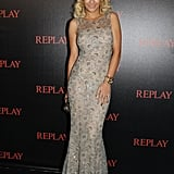 Rita Ora glammed it up in a formfitting nude gown at the Replay + Simple Minds concert.