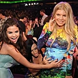 Selena Gomez and Katy Perry felt Fergie's pregnant belly in the audience of the Kids' Choice Awards.