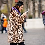 Style Your Leopard-Print Coat With: A Bright Hoodie and Black Jeans