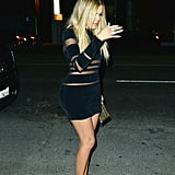 Khloé Wore a Supershort Long Sleeve Balmain Dress and Louboutin Pumps