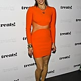 Paula Patton proved she's a force to be reckoned with in a little orange minidress, gold ankle-strap sandals, and tons of gold jewels at Robin Thicke's album release party in NYC.
