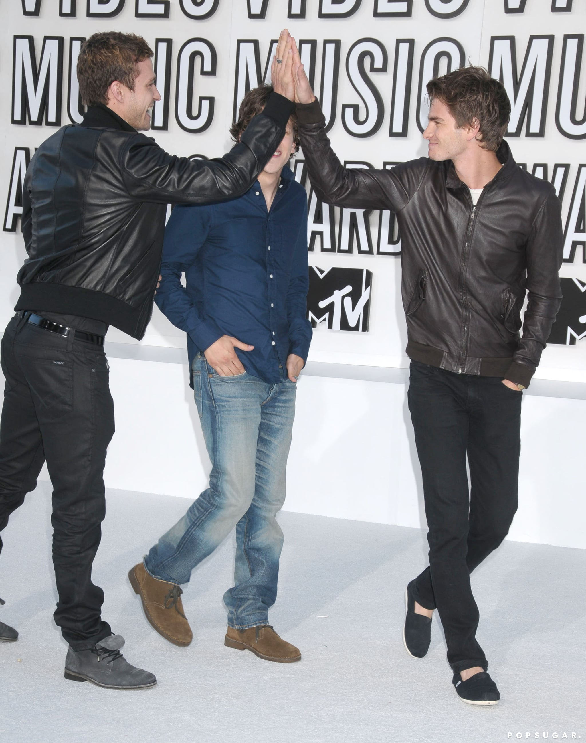 Justin Timberlake gave Andrew Garfield a high five when they attended the MTV VMAs with Jesse Eisenberg in 2010.