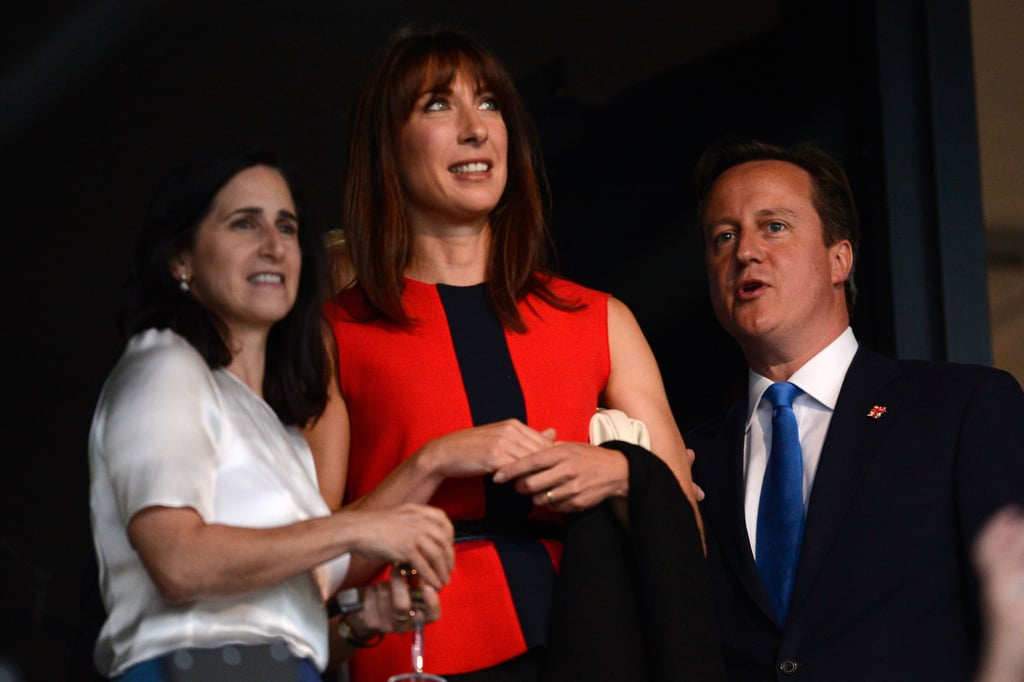 British Prime Minister David Cameron and his wife, Samantha, chatted with Marina Johnson, wife of London's mayor Boris Johnson, ahead of the opening ceremony.