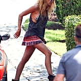 Blake Lively wore a bikini top and short skirt to film a scene for Savages in Newport Beach in September 2011.