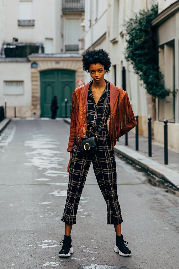 Wear a patterned jumpsuit with comfy sneakers.