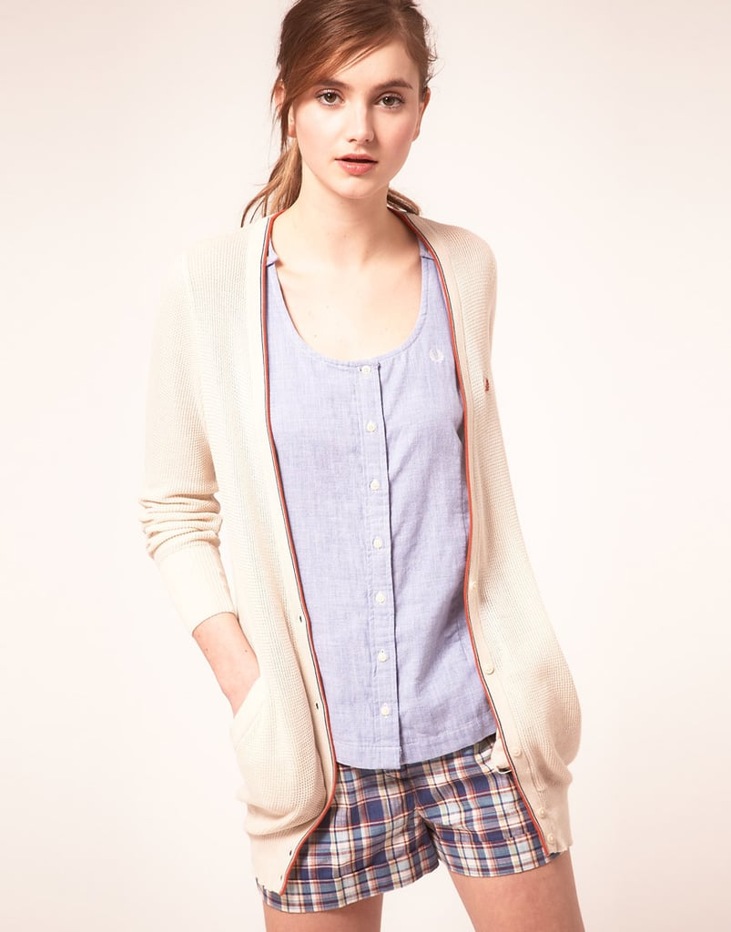 This boyfriend-inspired cardigan would lend a relaxed cool to your crisp and classic shorts and blouses for hitting the court in style.  Fred Perry Tipped Cardigan ($83, originally $166)