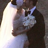 Anne Hathaway and Adam Schulman kissed for the cameras on their wedding day.