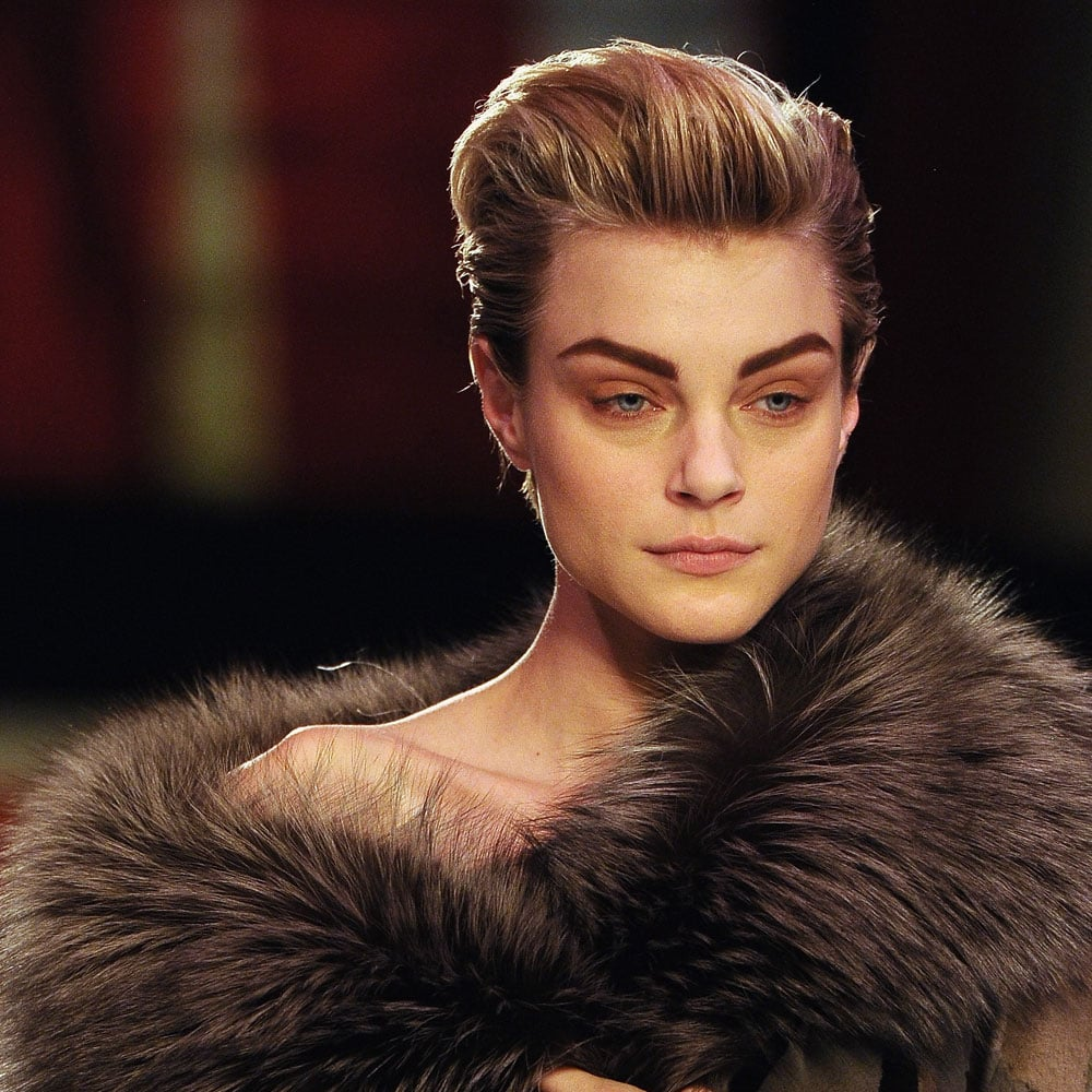 Jessica Stam can take the distinct honour of being the only model on the runway not to wear the same hair look as everyone else. Her short hair was swept back to put the emphasis on the strong brows created for the show.