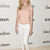 At a Hudson event at Neiman Marcus in Beverly Hills, Georgia May achieved the perfect mix of sweet and sexy in a gingham strapless top, white Hudson jeans, and red pumps.