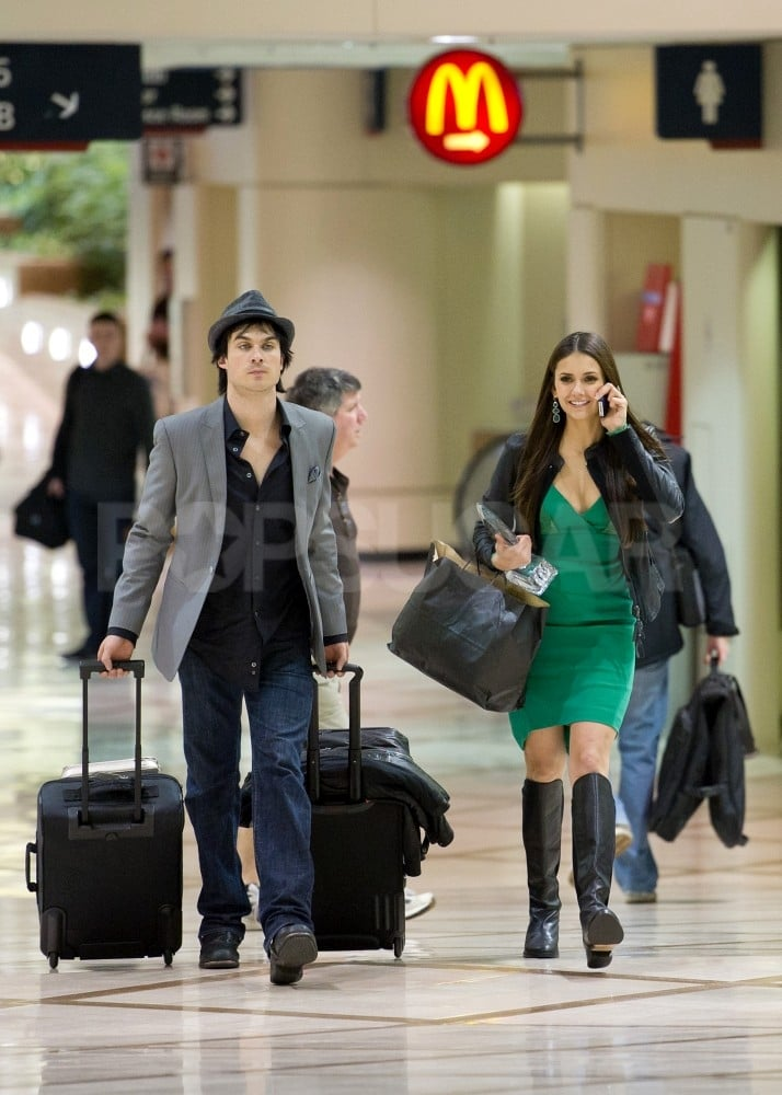 After the People's Choice Awards, Nina Dobrev covered up her Elie Saab dress with a leather jacket and headed to LAX with Ian Somerhalder.