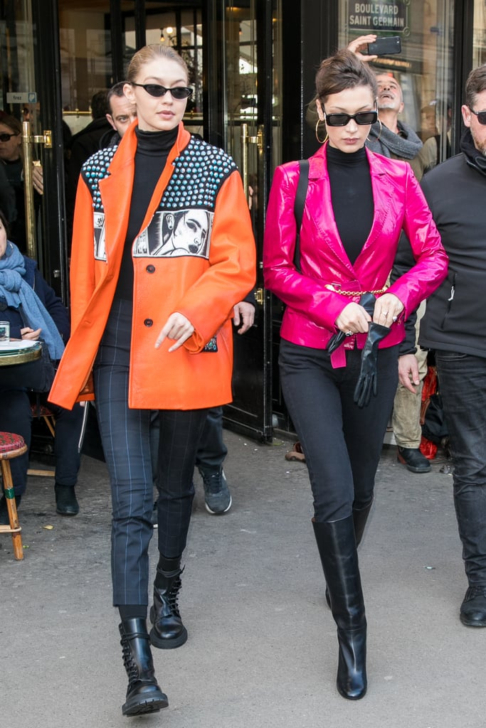 Gigi wore a Prada leather jacket from the Spring/Summer 2018 collection with a black turtleneck and pants.