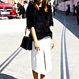 This street-snapped beauty paired a sharp white skirt with a black fuzzy top for a modern and chic color combo.