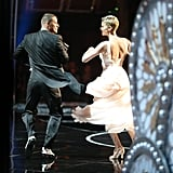 Channing Tatum and Charlize Theron on stage at the 2013 Oscars.