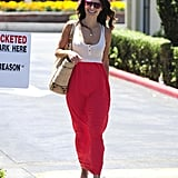 Jordana Brewster showed off a Summer-perfect look recently, tucking a white tank into a bright red maxi skirt, then adding a sweet straw tote bag.