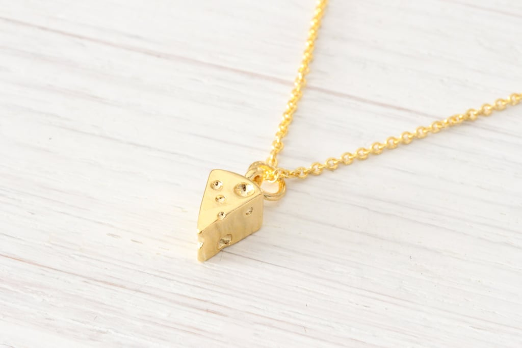 Tiny Gold Swiss Cheese Necklace ($10)