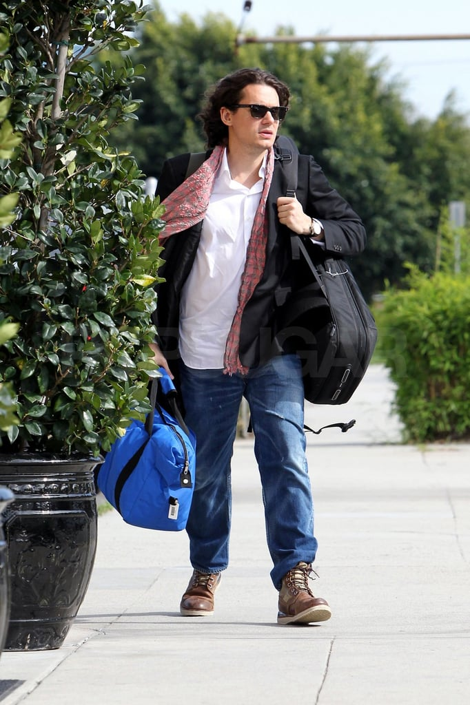 Pictures of John Mayer Carrying a Guitar in LA