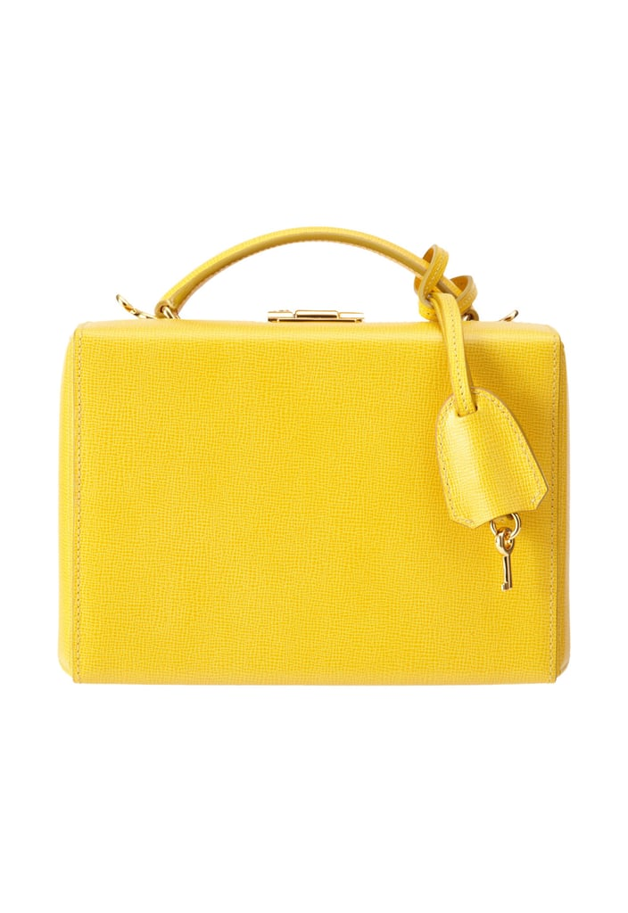 The golden days of travel, when steamer trunks and hat boxes were the accessory du jour, can be successfully mimicked with Mark Cross's hard-case bag ($1,695), perfect for packing your jewelry and cosmetics or simply for using as a purse.