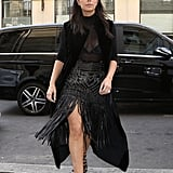 Kim showed off her legs in a playful leather fringe skirt while out and about in Paris in 2014.