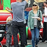 Naomi Watts was utilitarian cool in an army-green Madewell shirt at the Brentwood Farmers Market in LA.