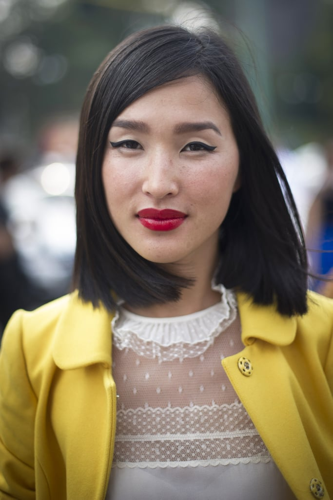 A sleek lob is classic with red lips and winged eyeliner.
