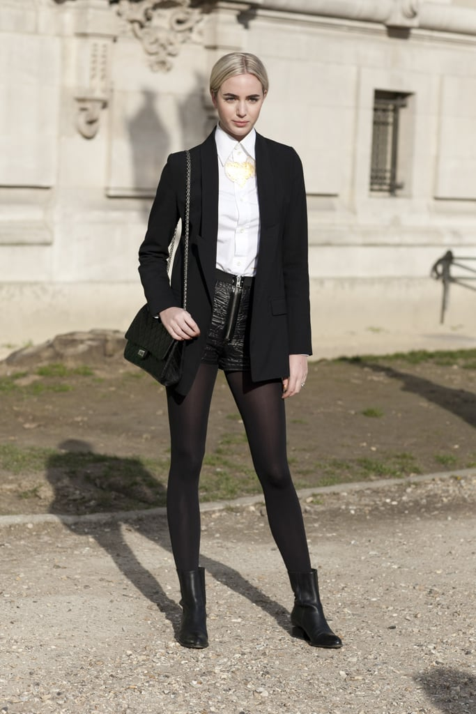 A black and white palette tied together leather shorts and menswear-inspired staples in this look.