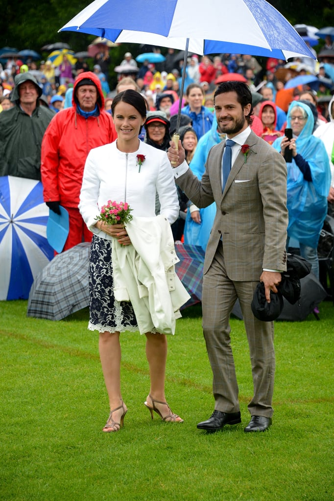 Prince Carl held an umbrella over his fiancée during a rainy July 2014 event in Öland, Sweden.