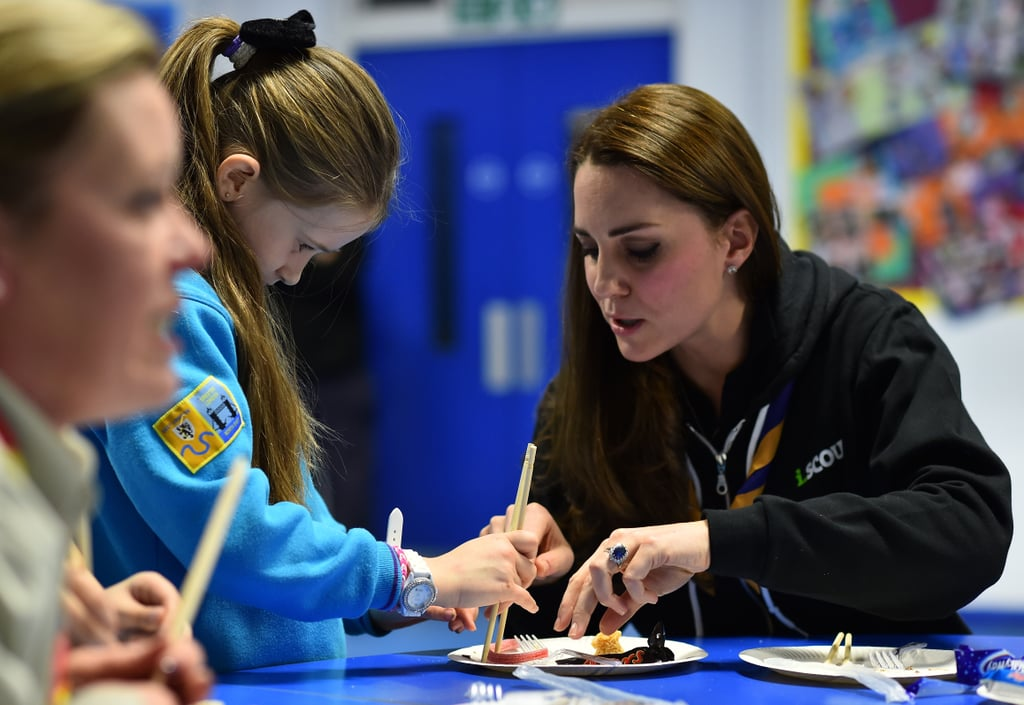 Kate adorably taught a girl how to use chopsticks during a December 2014 visit with a group of scouts in London.