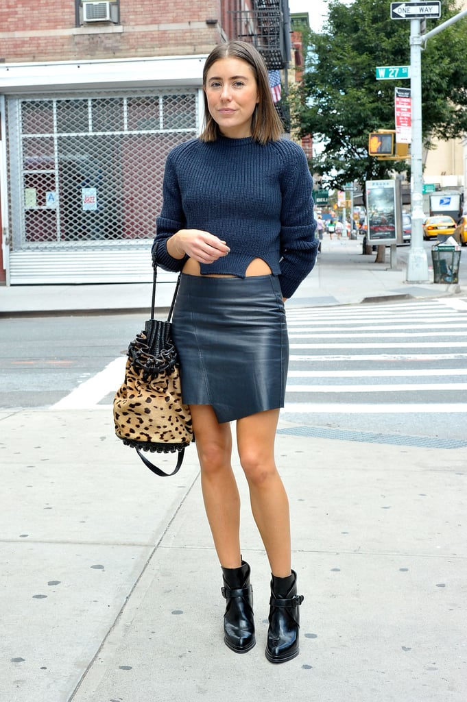 A leather miniskirt took this knit to a street-chic place — especially when styled with buckled ankle boots and a leopard-print bucket bag.