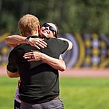 Harry hugged gold medalist Sarah Rudder at the 2017 Invictus Games in Toronto.