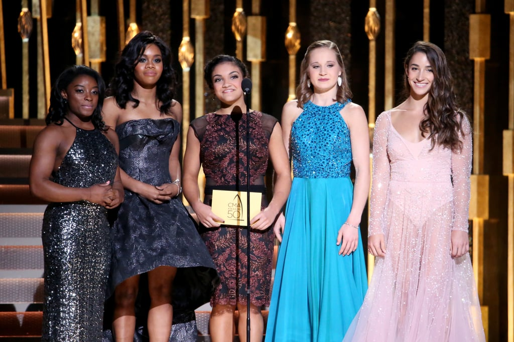 Simone Biles, Gabby Douglas, Laurie Hernandez, Aly Raisman, and Madison Kocian, better known as the Final Five, reunited at the CMA Awards in Nashville, TN, on Wednesday night. The girls were all smiles upon hitting the red carpet and showing off their stunning dresses for the cameras. Although they visited the White House and four of the girls attended the MTV VMAs in September, the event marked the group's first red carpet appearance as the Final Five since the Rio Olympics.        Related:                                                                                                           The Final Five Give Jimmy Fallon a Taste of Their Competitive Spirit in a Hilarious Tonight Show Game