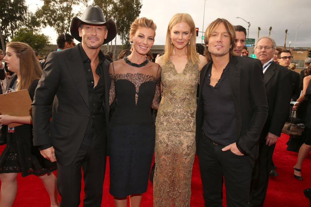 "Nicole Kidman wore gold Vera Wang to accompany her husband, Keith Urban, to the Grammys in LA tonight. Both Keith and Nicole have been award-season so far — she was up for two Golden Globes thanks to her small-screen work in Hemingway & Gellhorn and her big-screen work in The Paperboy. Tonight, though, is all about Keith, one of the evening's presenters. He's not nominated this year, but he's won plenty of Grammys before. He has a total of four, and most recently won best male country vocal performance for ""'Til Summer Comes Around"" in 2011. The fun has already started for Nicole and Keith — they caught up with pals Faith Hill and Tim McGraw on their way inside Staples Center."