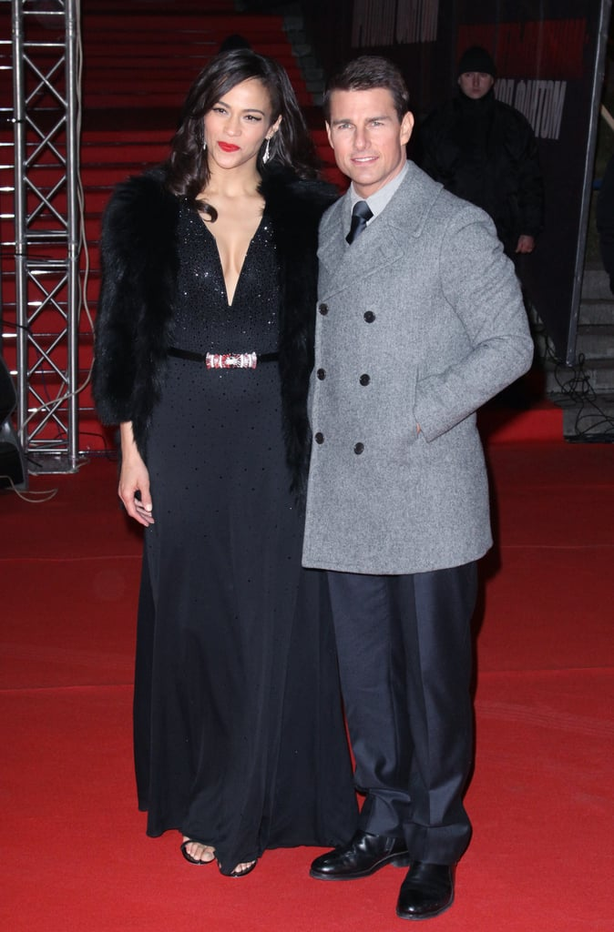 Tom Cruise and Paula Patton both wore warm coats in Moscow.