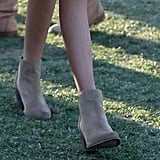 She kept it functional — and fashionable — in suede booties.