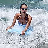 Alessandra Ambrosio rode waves in Maui on Sunday.