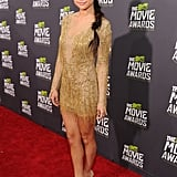 Selena Gomez shined in a gold beaded Julien Macdonald minidress and sparkly peep-toe Jimmy Choo pumps.