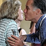 Mitt Romney goes in for the kiss during a Labor Day pancake breakfast in New Hampshire.