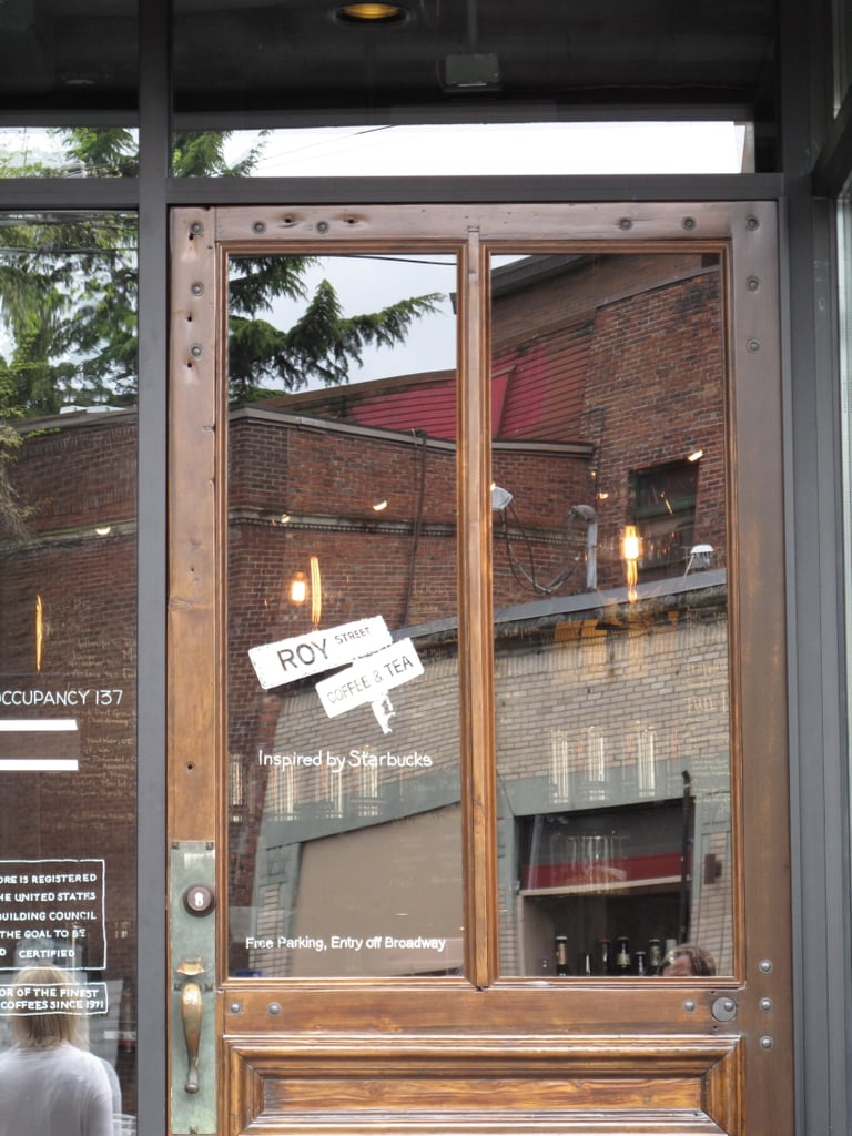 """The front door welcomes you to Roy Street Coffee & Tea, an establishment that's """"inspired by Starbucks."""" It was salvaged from an old movie set."""