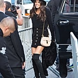 Sara Sampaio wearing a Chloé bag and Stuart Weitzman boots.