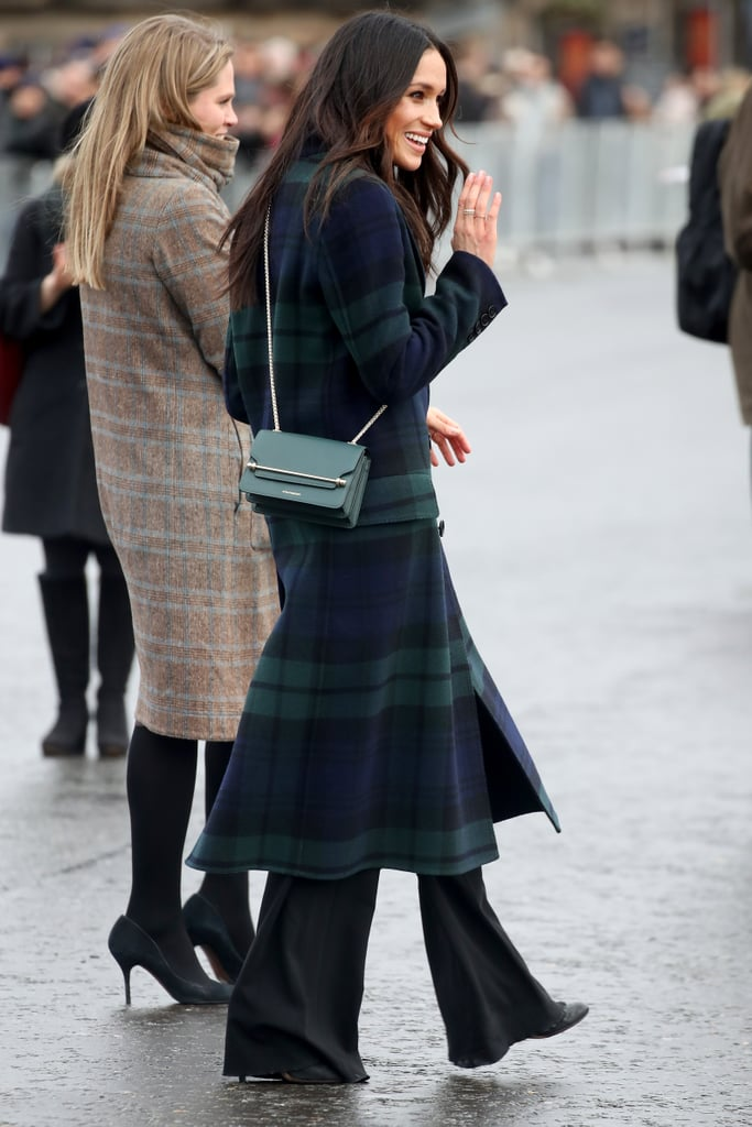 In February 2018, when Meghan and Harry made their first joint official visit to Scotland, she wore a Strathberry crossbody bag over her beautiful Burberry coat.