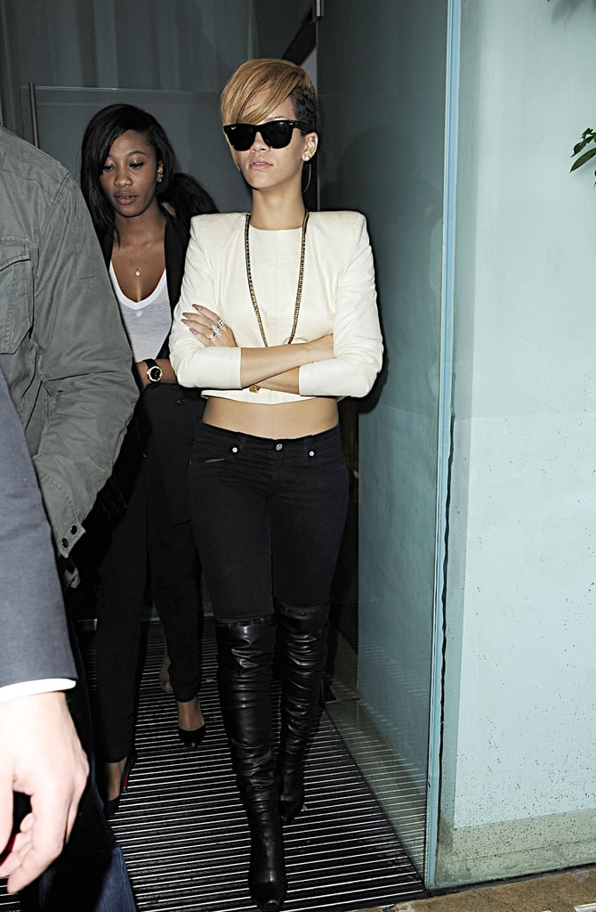 Black and white never looked so good. Rihanna hit the London streets in a midriff-baring top, body-hugging black denim, and sexy over-the-knee leather boots in November 2009.