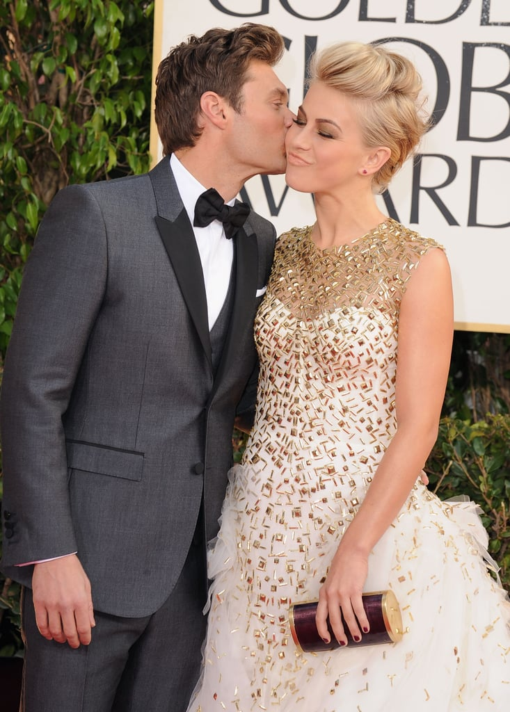 Ryan Seacrest gave Julianne Hough a kiss on the red carpet at the 2013 Golden Globes.