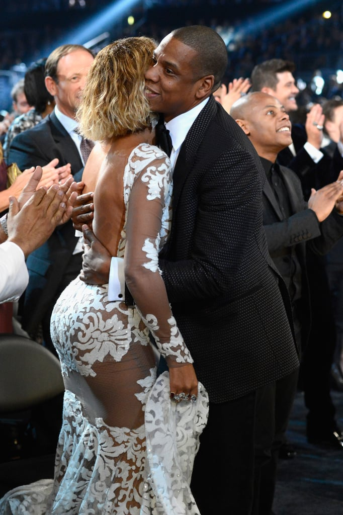 "Beyoncé Knowles was on fire at the Grammys in LA today. After opening the show with a super sexy performance of ""Drunk in Love"" with Jay Z, she stepped backstage, where she covered up her hot ensemble with an oversize jacket. Jay Z wrapped his arms around her as they hung out backstage. Later, she popped up in the audience in a cut-out white gown with a tuxedo-wearing Jay by her side. They shared a hug and a kiss after Jay picked up the award for best rap collaboration. Beyoncé isn't up for any awards solo today, but her collaboration with her husband, Jay Z — ""Part II (On the Run)"" — was up for best rap/sung collaboration; it lost to Jay Z's other collaboration, ""Suit & Tie"" with Justin Timberlake. Keep clicking for more of Beyoncé and Jay's Grammys night, and be sure to vote on all our Grammy Awards polls here!"
